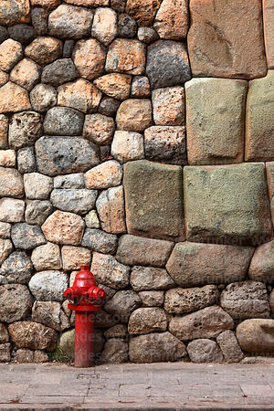 Red fire hydrant and Inca stone wall, Cusco, Peru