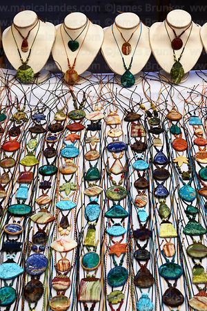 Necklaces with gemstones for sale in Pisac market, Sacred Valley, Peru