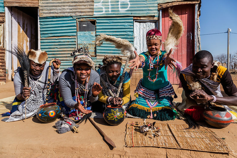 Sangoma (Traditional Healer) students pose for a photo in front of their school