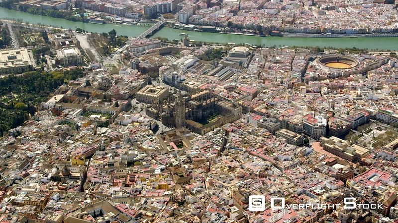CIRCLING AERIAL VIEW OF THE HISTORIC CENTER OF SEVILLE WITH CATHEDRAL AND LA GIRALDA IN CENTER, BULLRING 'LA MEASTRANZA' TO THE RIGHT, GUADALQUIVIR RIVER IN BACKGROUND SPAIN