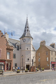 DUNBAR, SCOTLAND - JULY 17, 2018: The Dunbar Townhouse in High Street has been the focus of town life since the 16th century and a statue of the famous environmentalist John Muir.