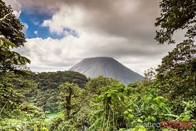 Sunset over Arenal volcano and rainforest, Costa Rica