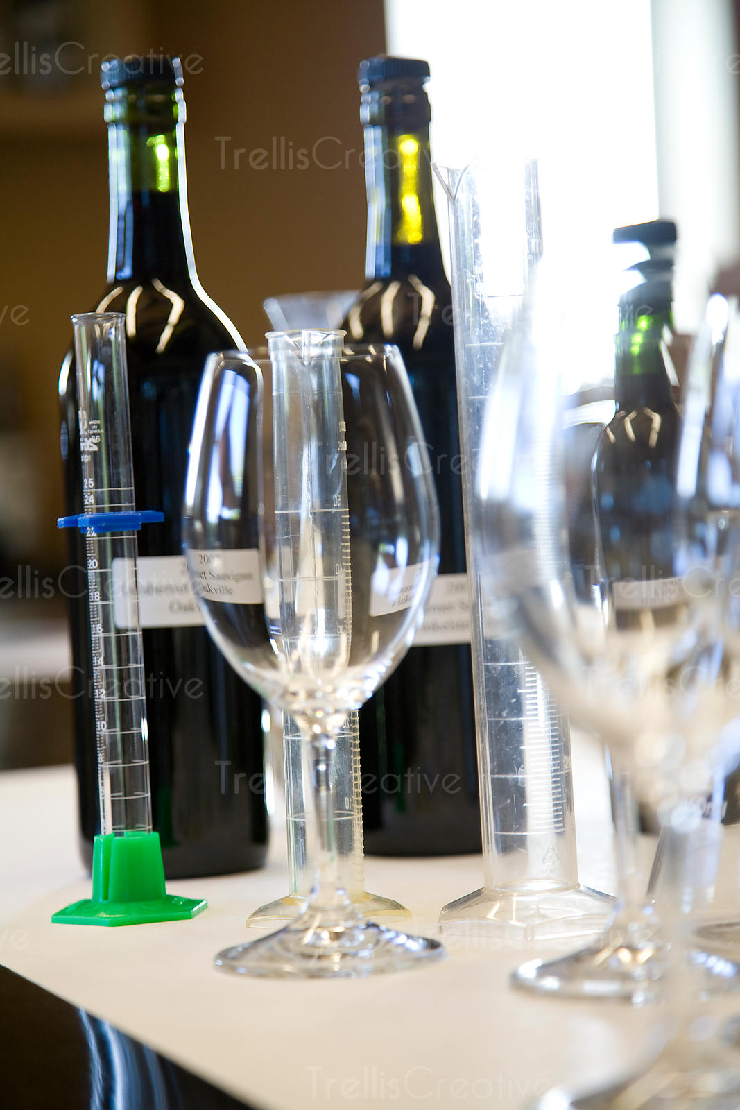 Empty glass beakers and wine glasses for blending wine