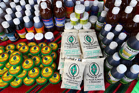 Cream for arthritis , bottles of various medicine and bags of coca leaf flour on stall at trade fair promoting alternative products made from coca leaves , La Paz , Bolivia