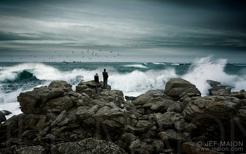 Couple watching sea storm weather