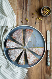 Cake on grey plate with powdered sugar
