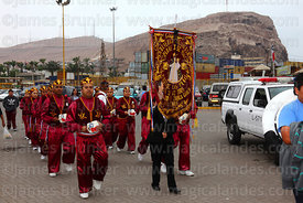 Morenos dance group arriving at port at start of St Peter and St Paul festival, Arica, Chile
