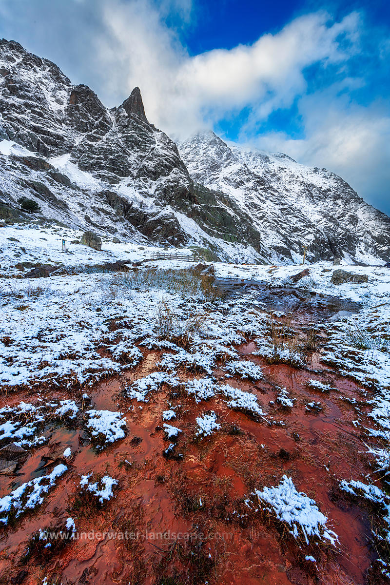 Red stream in snowy pyrenees