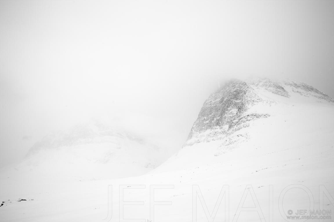 Snow-capped mountain in fog