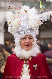 Woman in St Mark's Square in period costume and an Exotic  White Wig