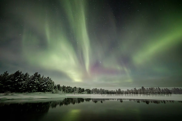 Reflection of the Aurora on open water near Inari, Finnish Lapland