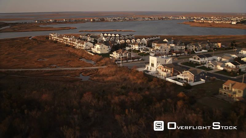 Over residential area and Lagoon Boulevard in Brigantine, New Jersey. Shot in November