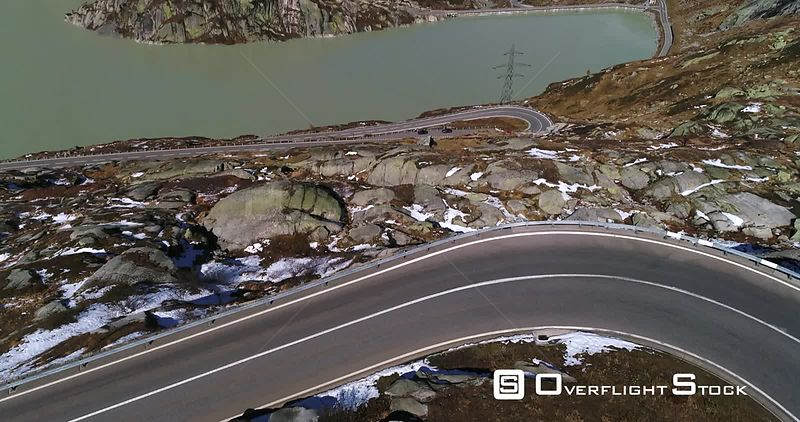 Alpine Lake, 4k Aerial Tilt View of a Snowy Alps, the Grimsel Hospiz and the Grimselsee on Grimsel Pass, Sunny Autumn Day, Bern, Alps of Switzerland