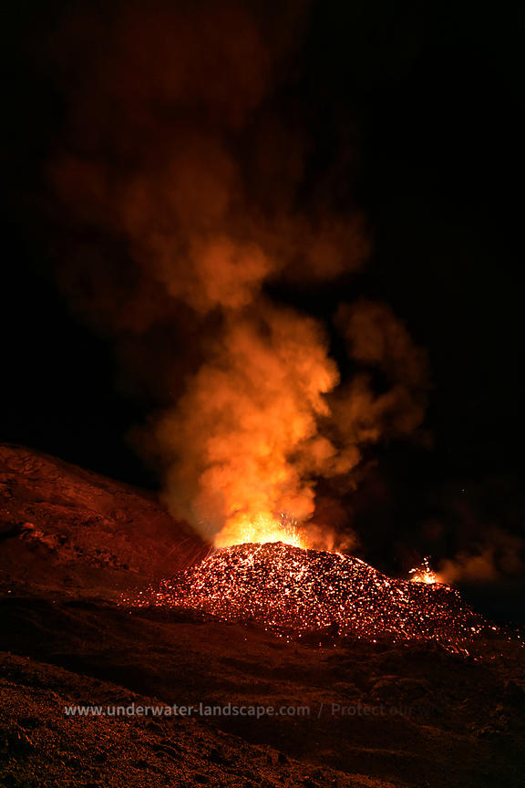 Volcanic eruption by night