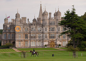 A rider exercising in front of Burghley House - Burghley Horse trials 2011