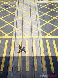 Man rushing on zebra crossing, Hong Kong