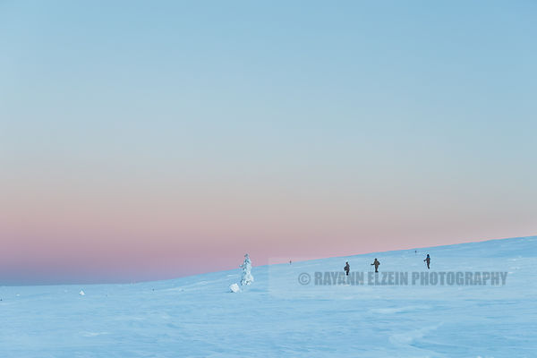 Snowshoeing in pink light