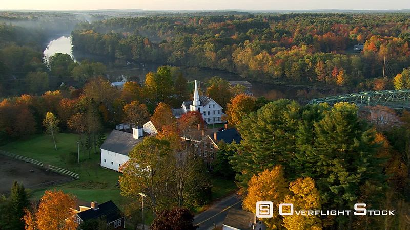 Flying over Maine village in autumn