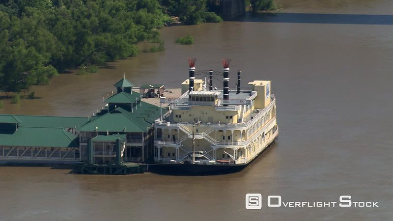 Flight past riverboat docked at pavilion on Mississippi near Baton Rouge, Louisiana.
