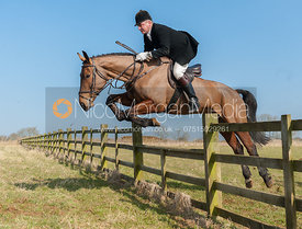 Michael Dungworth jumping a hunt jump near the meet at Goadby Marwood