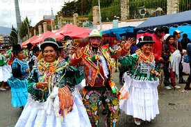 Ch'uta dancing with cholitas during parades for the Entierro del Pepino, La Paz, Bolivia