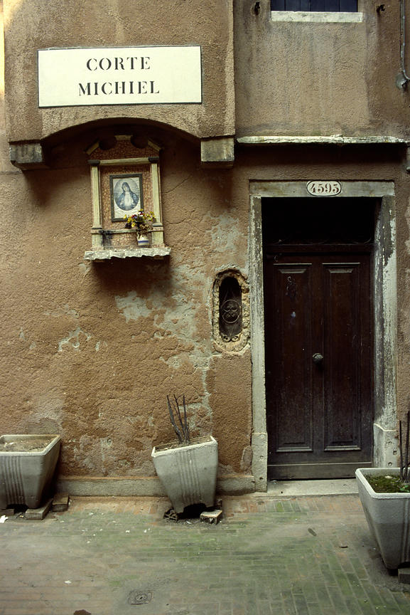 Italy - Venice - A shrine by a door in a residential street in Venice
