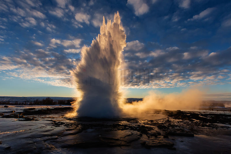 Geyser Strokkur Erupting at Sunrise