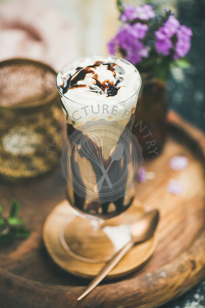 Iced mocha coffee with whipped cream in glass