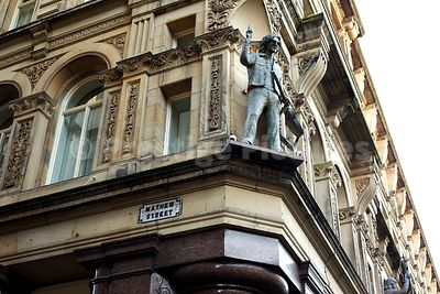 Statue of John Lennon with Guitar high on a Building at the Corner of Mathew Street
