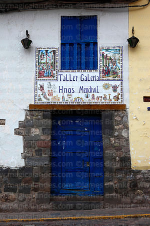 Ceramic decorations on entrance of handicraft shop in San Blas district, Cusco, Peru