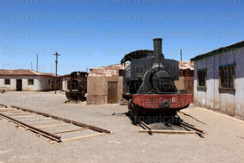 Old steam engine in abandoned nitrate mining town of Humberstone, Region I, Chile