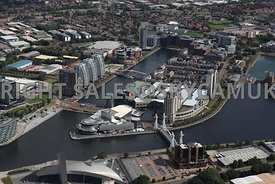 Manchester aerial photograph looking across from Trafford Wharf road towards the Lowry Centre and Salford Quays