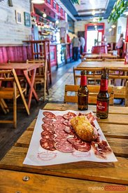 Interior of typical taberna with salami on the table, Spain