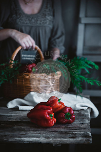 Red peppers on a rustic kitchen table
