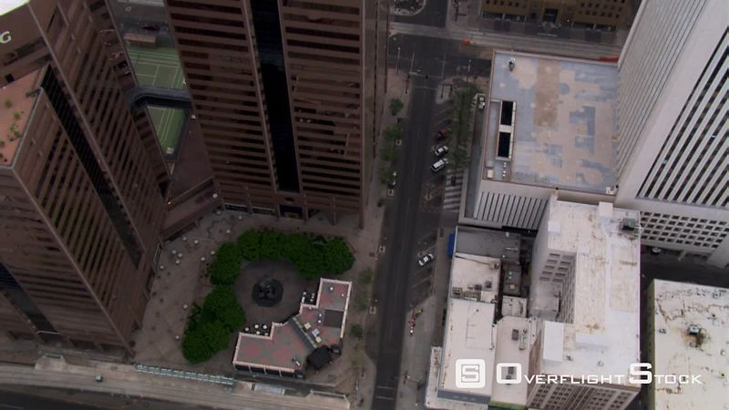 Flight over Phoenix skyscrapers, steep look down.