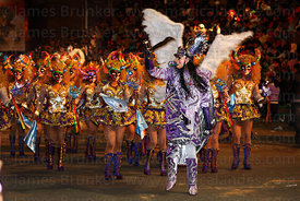 Archangel Michael leading China Supay female devils during the Diablada dance at night, Oruro Carnival, Bolivia