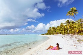 Woman on sandy beach, Aitutaki, Cook Islands
