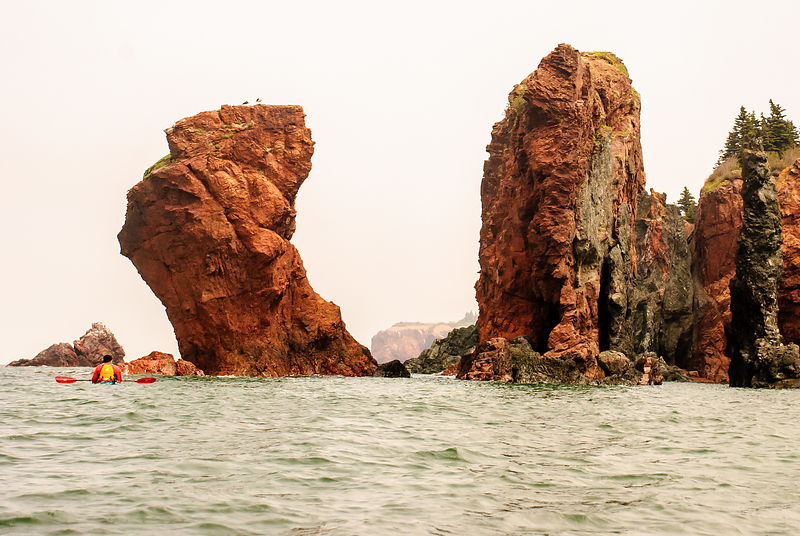 Kayaking in Bay of Fundy near Cape Chignecto, Nova Scotia