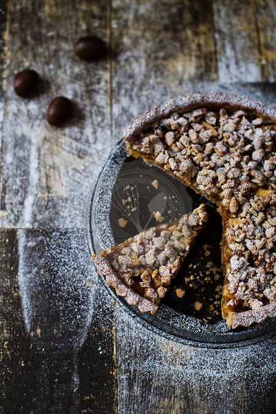 Gluten free tart with chestnut eggless crust, filled with marmelade, candied apples and walnuts
