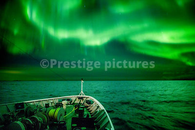 "Aurora Borealis at Sea showing over the bows of the Hurtigruten ship MS ""Richard With"" in the Vågan municipality in Norway"