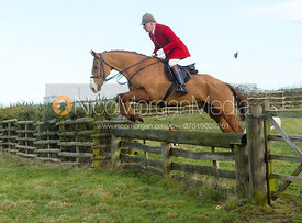 Andrew Osborne jumping a hunt jump at Hill Top Farm