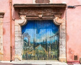 Gate decorated with a trompe l'oeil, Roussillon, France