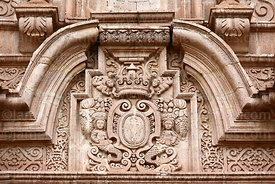 Ave Maria and mermaid carvings on main entrance facade of church of Santiago the Apostle / Immaculate Conception, Lampa, Peru
