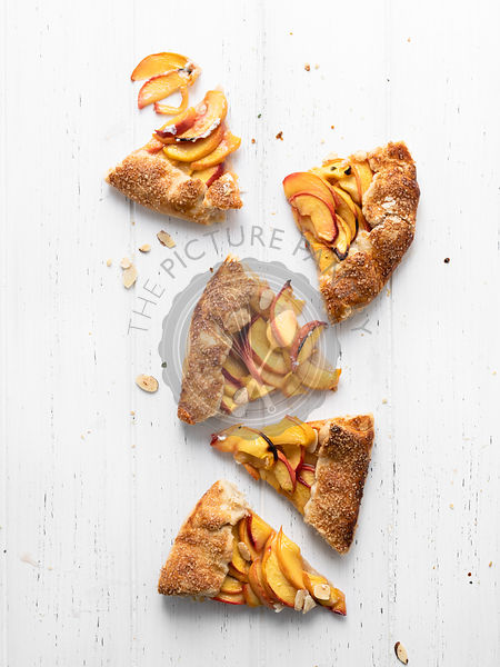 Peach Galette made with fresh yellow peaches, honey, and lemon thyme.