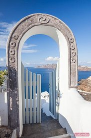 Entrance with mediterranean sea and island  Oia Santorini Greece