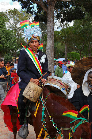 King of the achus riding a cow during festival parades, San Ignacio de Moxos, Bolivia