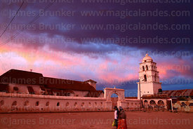 "Village square, belfry and main building of the so called ""Sistine Chapel of the Andes"" / Capilla Sixtina de los Andes at sunset, Curahuara de Carangas, Oruro Department, Bolivia"