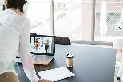 Businesswoman having a video conference in office
