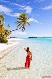 Woman in the blue sea of One Foot Island, Aitutaki