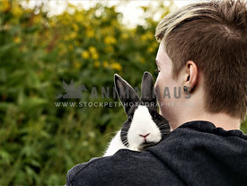 Dutch rabbit held by girl